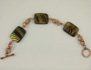 Copper tone with Swirl Accent Bead Bracelet